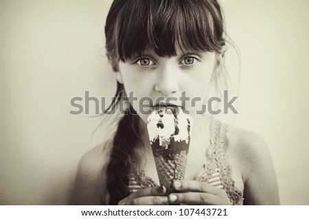 Cute brunette little girl eating ice cream, retro style, artistic noise added