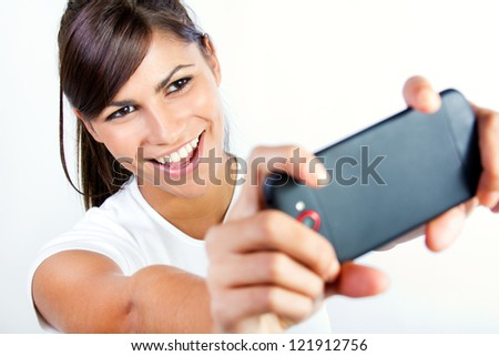 Cute brunette woman taking photo of herself. Isolated.