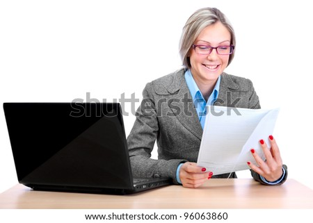 Cute business woman wearing spectacles, working on a laptop