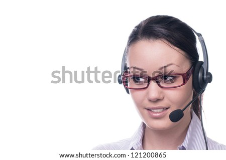 Cute business woman with headset at workplace
