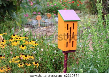 Cute butterfly house in ornamental garden in summer
