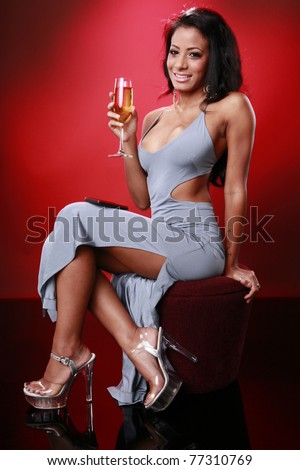 Cute caribbean girl texting about her drink - stock photo