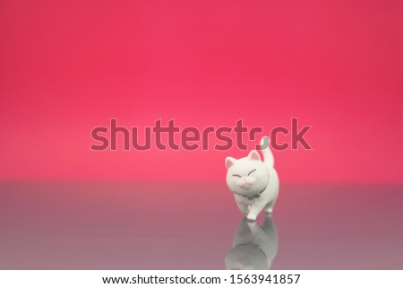 Cute cat or kitten figure walking isolated in pink background. Animal lover or quotes concept.
