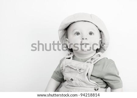 Cute caucasian baby boy wearing a hat