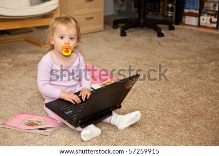 Forumistët bebe... Stock-photo-cute-caucasian-baby-girl-playing-with-black-laptop-computer-57259915