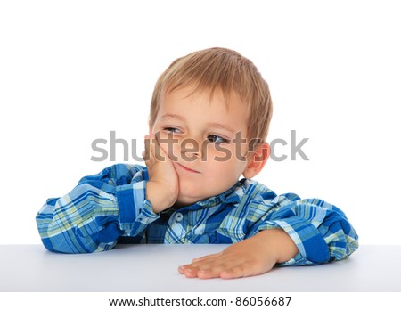 Cute caucasian boy looking bored. All on white background. - stock photo