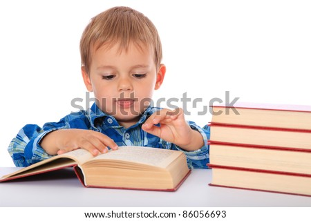 Cute caucasian boy looking through a book. All on white background.