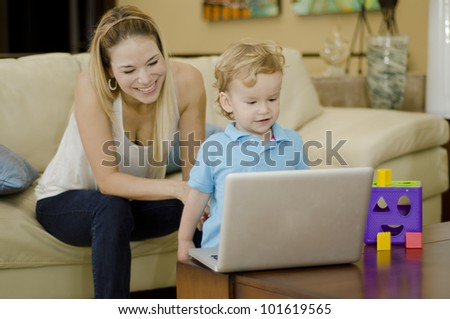 Cute caucasian kid playing and having fun with her mom