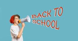 Cute Caucasian teen School boy using megaphone. Back to school text on blue banner. Copy space edgeless