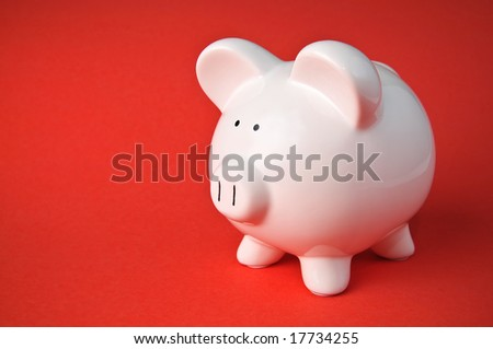 Cute Ceramic Piggy Bank Savings Isolated on Solid Red Gradient Background