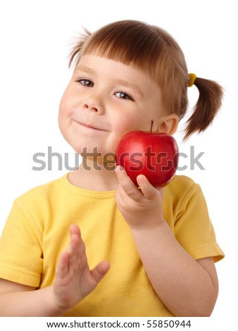 Cute cheerful child is going to bite a red apple, isolated over white