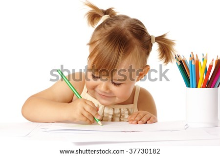 Cute child draw with color pencils and smile, isolated over white
