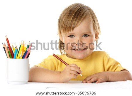 Cute child draw with crayons and smile, isolated over white