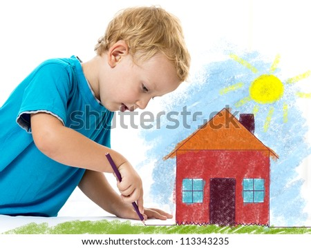 Cute child drawing a house - stock photo