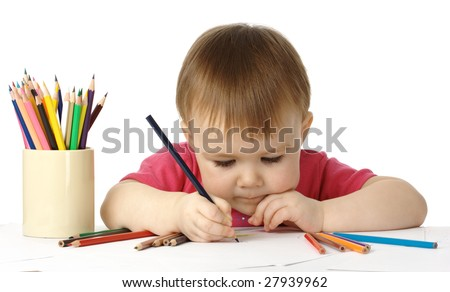 Cute child, focused, drawing on white paper, isolated