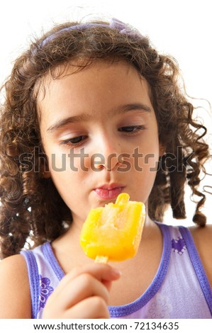 Cute child girl eating popsicle on white .