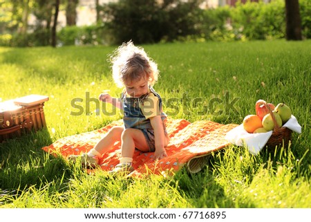 Cute child having picnic in park