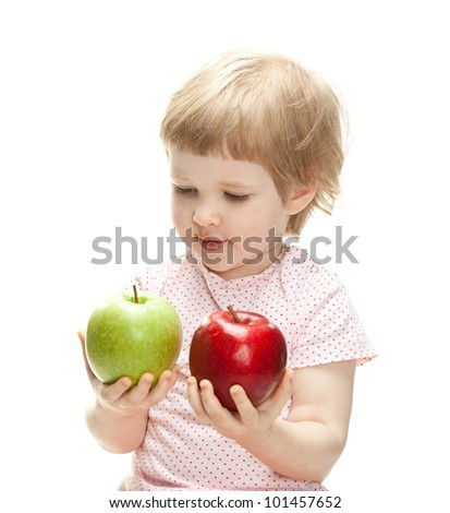 Cute child holding apples looking and them, isolated on white