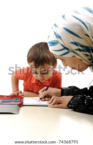 Cute child is painting and playing with his mother