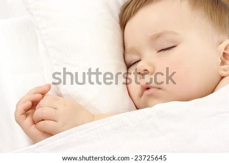 Cute child is sleeping, high key portrait