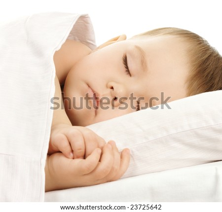 Cute child is sleeping in bed, isolated over white