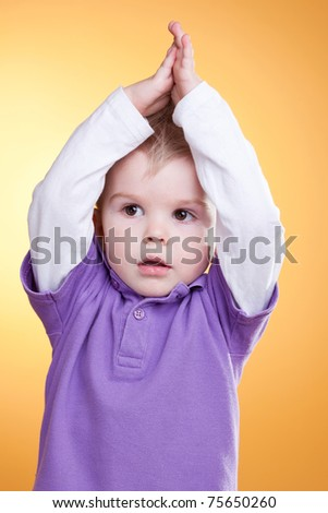 Cute child make hairstyle himself
