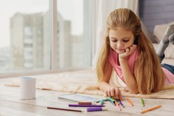 Cute child painting by felt-tip pens