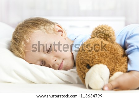 Cute child sleeping in bed