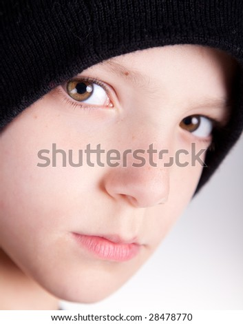 Cute child with a pensive look close up.