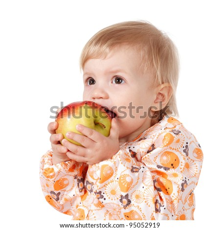 Cute child with a red apple.