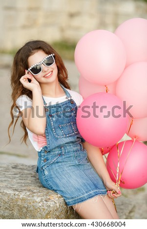 b29a97288 Royalty-free Happy little girl with balloons summer…  603711977 ...
