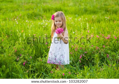 Cute child with bouquet of field flowers