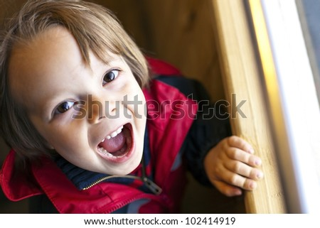 Cute Child with toothy smile with available light