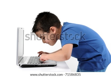 Cute child working on computer isolated on white background - see more COMPUTER images.