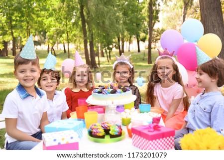 Cute children celebrating birthday outdoors #1173201079