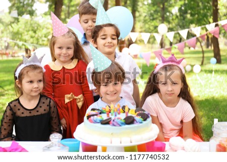 Cute children celebrating birthday outdoors #1177740532