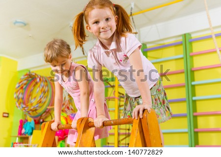 Cute children playing in kindergarten gym