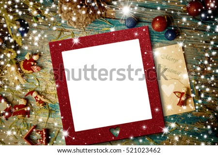 Cute Christmas ornaments and stars with empty photo frame on rustic background