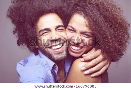 Cute couple both with an afro posing