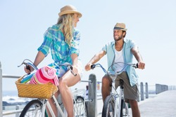 Cute couple on a bike ride on a sunny day
