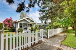 Cute craftsman home exterior with picket fence. Northwest, USA