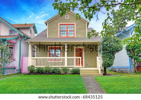 Cute craftsman style small green house. Tacoma, USA.