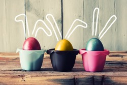 Cute creative photo with easter eggs in the nest