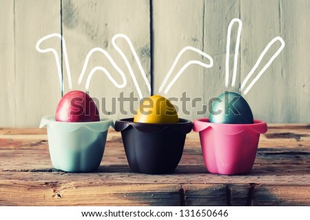 Cute creative photo with easter eggs in the nest stock photo