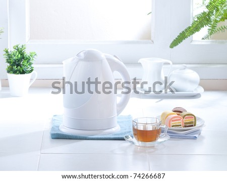 Cute design of the electric kettle in the kitchen interior