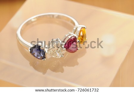 Cute design ring with 4 stones. Ruby, yellow sapphire, Blue Sapphire and diamond.
