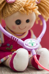 Cute doctor doll with a stetoscope