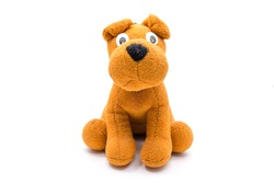 Cute dog brown doll/toy isolated on a white background
