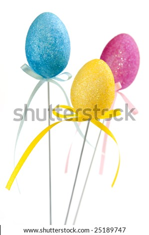 Cute Easter toy eggs isolated on white background
