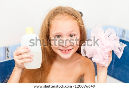 Cute eight year old girl taking a relaxing bath with foam. The symbol of purity and hygiene education.
